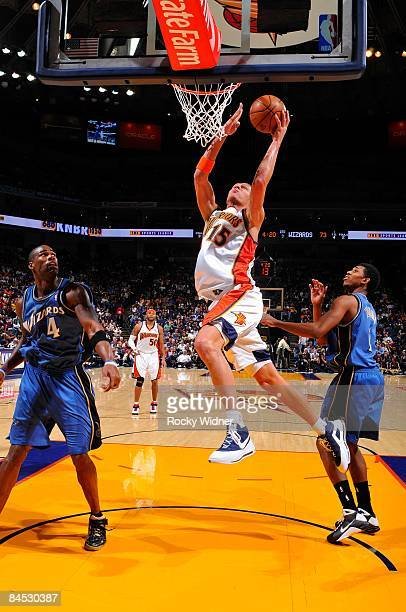 Andris Biedrins of the Golden State Warriors lays up a shot during the game against the Washington Wizards on January 19 2009 at Oracle Arena in...