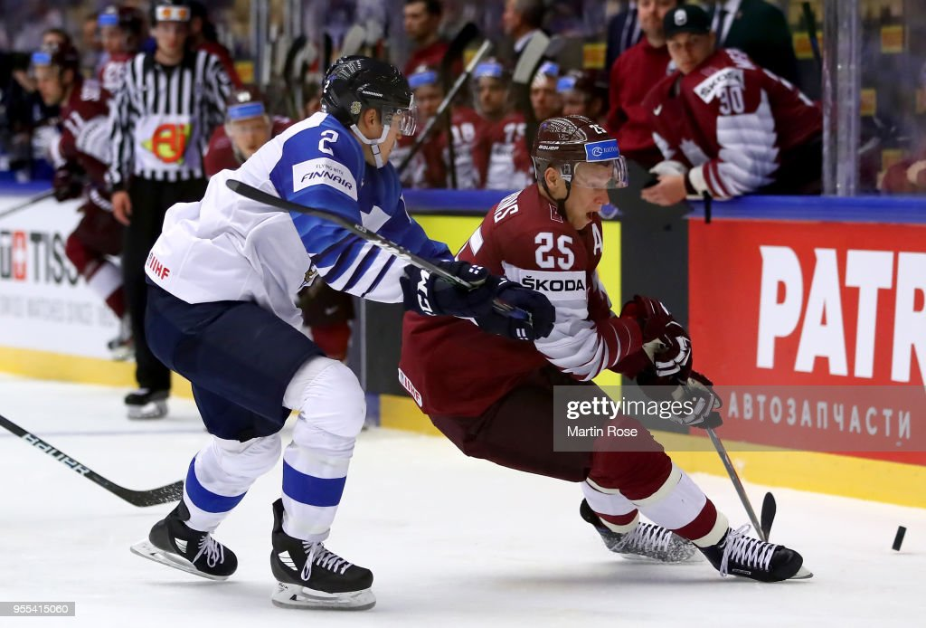 Andris Dzerins #25 of Latvia and Ville Pokka #2 of Finland battle for the puck during the 2018 IIHF Ice Hockey World Championship group stage game between Latvia and Finland at Jyske Bank Boxen on May 6, 2018 in Herning, Denmark.