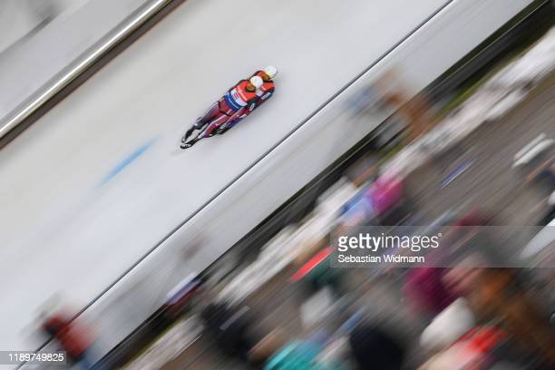 Andris Sics and Juris Sics of Latvia compete in the Relay competition during the FIL Luge World Cup at OlympiaRodelbahn on November 24 2019 in...