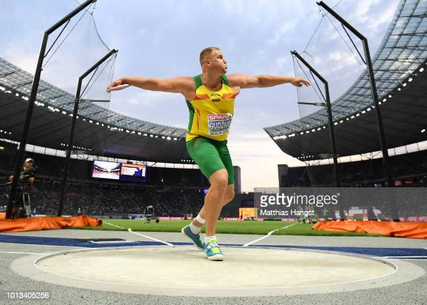 Andrius Gudzius of Lithuania competes in the men's Discus Throw Final during day two of the 24th European Athletics Championships at Olympiastadion...