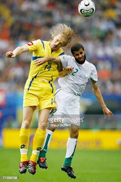 Andriy Gusin of Ukraine jumps for a header with Abdulaziz Khathran of Saudi Arabia during the FIFA World Cup Germany 2006 Group H match between Saudi...