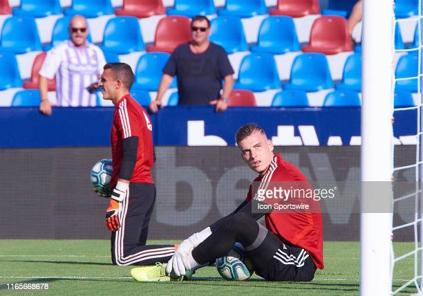 Andriy Lunin and Jordi Masip goalkeepers of Real Valladolid CF warms up prior the La Liga match between Levante UD and Real Valladolid CF at Ciutat...