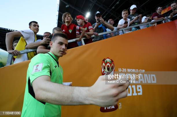 Andriy Lunin goalkeeper of Ukraine takes a selfie after the 2019 FIFA U20 World Cup Round of 16 match between Ukraine and Panama at Tychy Stadium on...