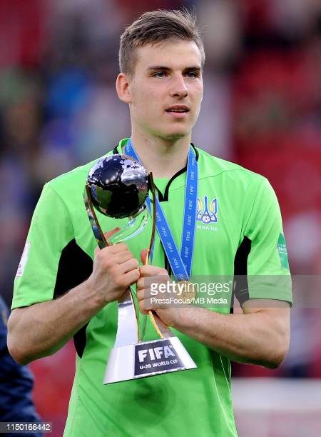 Andriy Lunin of Ukraine celebrates with the trophy after winning the World Championship during the FIFA U20 World Cup match between Ukraine and Korea...