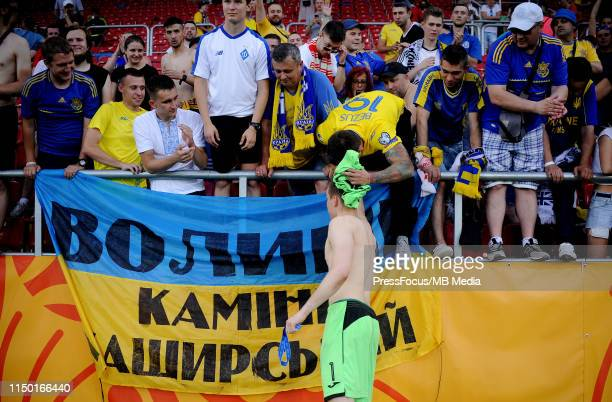 Andriy Lunin of Ukraine gives the fans a shirt during the FIFA U20 World Cup match between Ukraine and Korea Republic on June 15 2019 in Lodz Poland