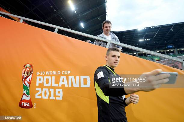 Andriy Lunin of Ukraine takes a selfie with a fan following the 2019 FIFA U20 World Cup group D match between Qatar and Ukraine at Tychy Stadium on...