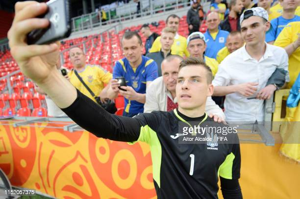 Andriy Lunin of Ukraine takes a selfie with fans following victory in the 2019 FIFA U20 World Cup group D match between Qatar and Ukraine at Tychy...