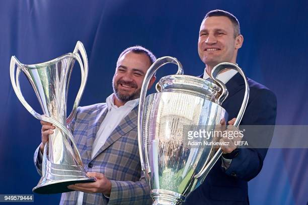 Andriy Pavelko president of the Football Federation of Ukraine and Kyiv Mayor Vitali Klitschko hold cups during the UEFA Champions League Trophy...