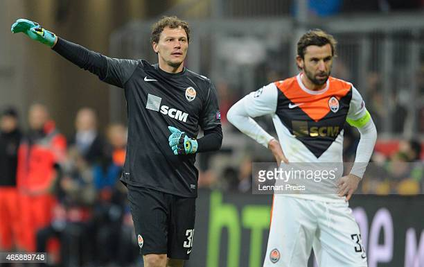 Andriy Pyatov of Shakhtar Donetsk reacts next to his teammate Darijo Srna during the UEFA Champions League Round of 16 second leg match between FC...