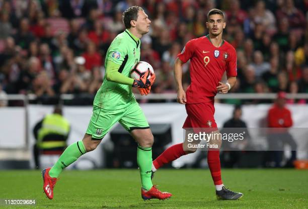Andriy Pyatov of Ukraine with Andre Silva of Portugal and Sevilla FC in action during the UEFA Euro 2020 Qualifier match between Portugal and Ukraine...