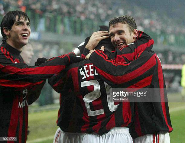 Andriy Shevchenko Clarence Seedorf and Kaka Kaka of Milan celebrate a goal during the Campionato Italiano match between AC Milan and Inter Milan at...