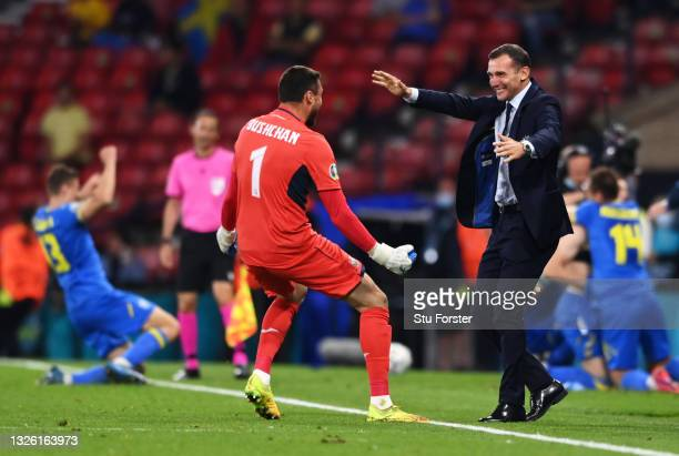 Andriy Shevchenko, Head Coach of Ukraine celebrates with Georgiy Bushchan after their side's second goal scored by Artem Dovbyk of Ukraine during the...