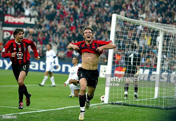 Andriy Shevchenko of AC Milan celebrates adter scoring during the Champions League Quarter Final First leg match between AC Milan and Inter Milan at...