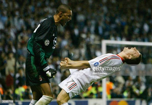 Andriy Shevchenko of AC Milan celebrates scoring the winning goal with goal keeper Dida during the UEFA Champions League Final match between Juventus...