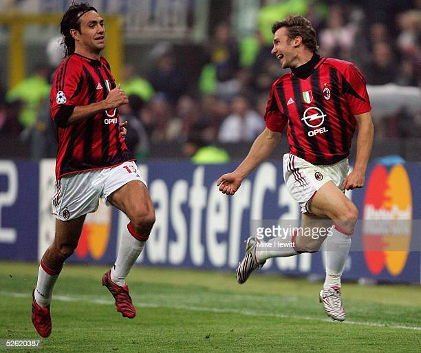 Andriy Shevchenko of AC Milan celebrates with teammate Alessandro Nesta after scoring during the UEFA Champions League quarterfinal second leg...