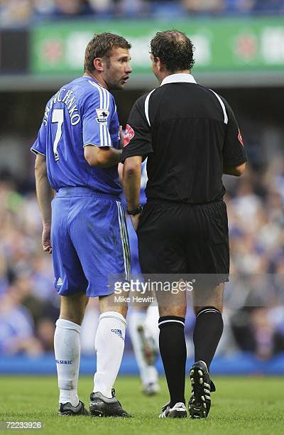 Andriy Shevchenko of Chelsea talks to referee Mark Clattenburg as he is booked for overcelebrating during the Barclays Premiership match between...