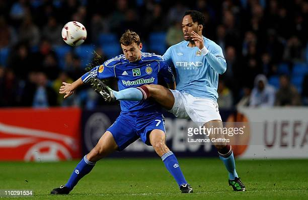 Andriy Shevchenko of Dynamo Kiev is challenged by Joleon Lescott of Manchester City during the UEFA Europa League round of 16 second leg match...