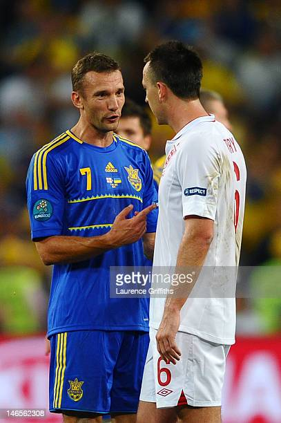 Andriy Shevchenko of Ukraine and John Terry of England speak after the UEFA EURO 2012 group D match between England and Ukraine at Donbass Arena on...