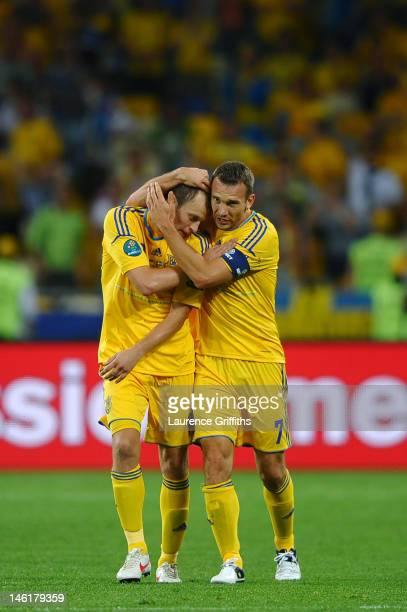 Andriy Shevchenko of Ukraine celebrates scoring their first goal with Oleh Husyev of Ukraine during the UEFA EURO 2012 group D match between Ukraine...