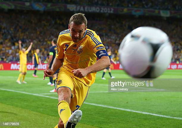 Andriy Shevchenko of Ukraine celebrates scoring their second goal by kicking the ball during the UEFA EURO 2012 group D match between Ukraine and...