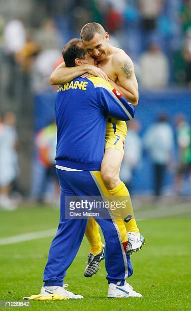 Andriy Shevchenko of Ukraine is embraced by a member of his team's coaching staff following his team's victory at the end of the FIFA World Cup...