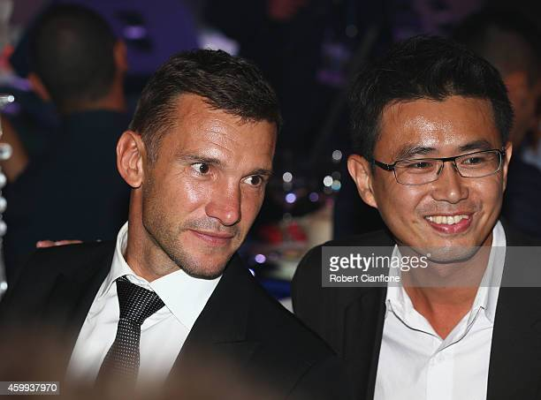 Andriy Shevchenko poses with a guest during the Global Legends Series Gala Dinner at the Swissotel on December 4 2014 in Bangkok Thailand