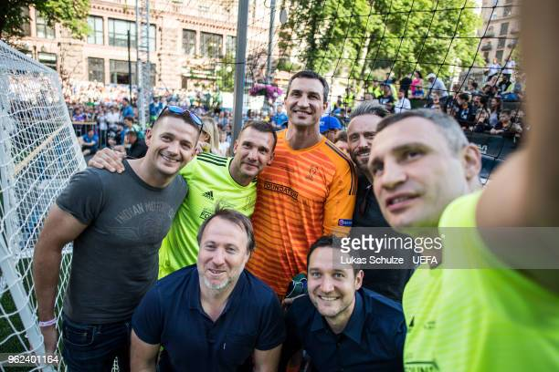 Andriy Shevchenko Vitali Klitschko and Wladimir Klitschko taking a selfie are seen during the Ultimate Champions Tournament at the Champions Festival...