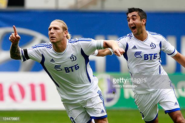 Andriy Voronin celebrates with Aleksandr Samedov of FC Dynamo Moscow after scoring the opening goal during the Russian Premier League match between...