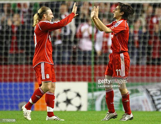 Andriy Voronin congratulates team mate Yossi Benayoun of Liverpool after he scored his team's second goal during the UEFA Champions League Group A...
