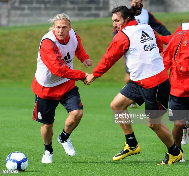 Andriy Voronin in action with new signing Sotirios Kyrgiakos of Liverpool during a training session at Melwood on August 28 2009 in Liverpool England