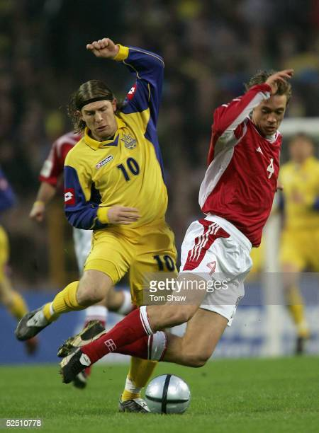 Andriy Voronin of Ukraine tussles with Per Kroldrup of Denmark during the Ukraine v Denmark World Cup Group 2 qualifying match at the Olympic Stadium...