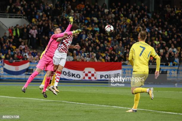 Andriy Yarmolenko and Sime Vrsaljko of Ukraine in action against Croatian goalkeeper Danijel Subasic during the FIFA 2018 World Cup Group I Qualifier...