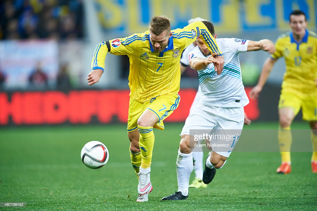 Andriy Yarmolenko from Ukraine fights for the ball with (R) Bojan Jokic of Slovenia during the UEFA EURO 2016 Play-off for Final Tournament, First leg between Ukraine and Slovenia at Lviv Arena on November 14, 2015 in Lviv, Ukraine.