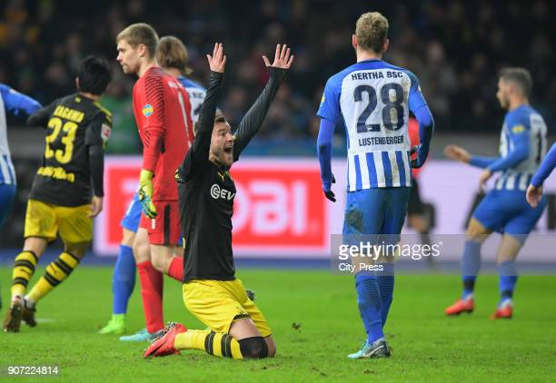 Andriy Yarmolenko of Borussia Dortmund and Fabian Lustenberger of Hertha BSC during the game between Hertha BSC and Borussia Dortmund on january 19...