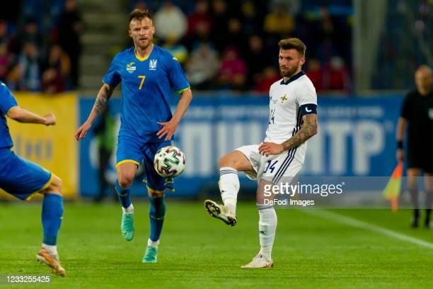 Andriy Yarmolenko, of Ukraine and Stuart Dallas of Northern Ireland battle for the ball during the international friendly match between Ukraine and...