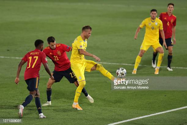Andriy Yarmolenko of Ukraine battles for possession with Sergio Reguilon of Spain during the UEFA Nations League group stage match between Spain and...