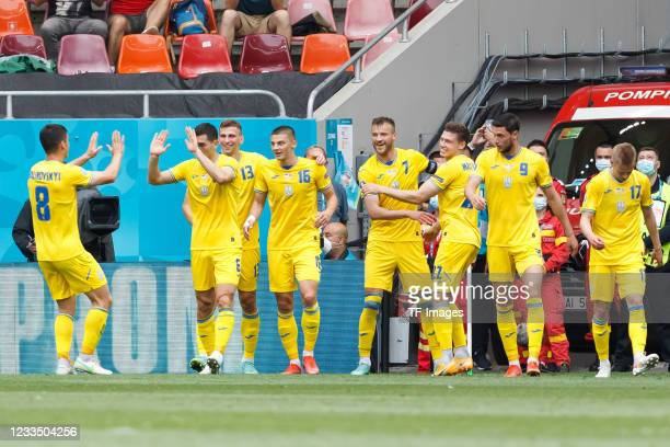 Andriy Yarmolenko of Ukraine celebrates after scoring his team's first goal with teammates during the UEFA Euro 2020 Championship Group C match...