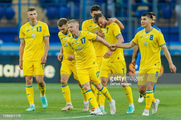 Andriy Yarmolenko of Ukraine celebrates after scoring his team's third goal with teammates during the international friendly match between Ukraine...