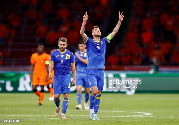 Andriy Yarmolenko of Ukraine celebrates after scoring their side's first goal during the UEFA Euro 2020 Championship Group C match between...