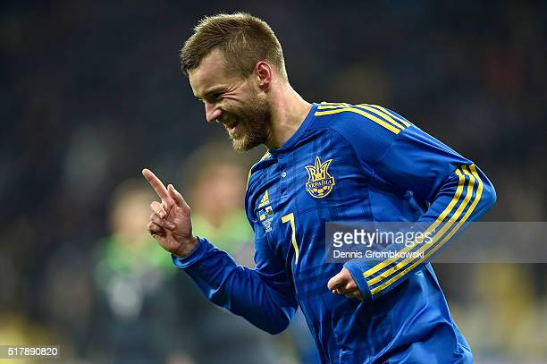 Andriy Yarmolenko of Ukraine celebrates as he scores the opening goal during the International Friendly match between Ukraine and Wales at NSK...
