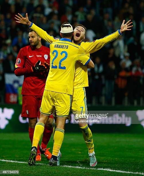 Andriy Yarmolenko of Ukraine celebrates his goal with Artem Kravets to qualify during the UEFA EURO 2016 qualifier playoff second leg match between...