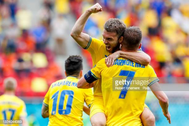 Andriy Yarmolenko of Ukraine celebrates with Oleksandr Karavaev after scoring their side's first goal during the UEFA Euro 2020 Championship Group C...
