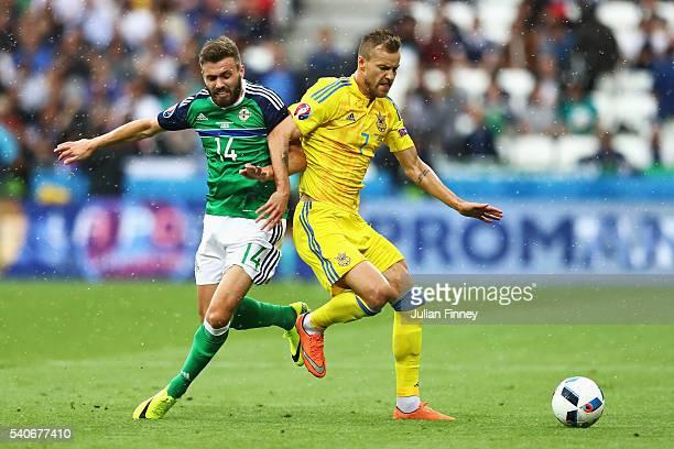 Andriy Yarmolenko of Ukraine controls the ball under pressure of Stuart Dallas of Northern Ireland during the UEFA EURO 2016 Group C match between...