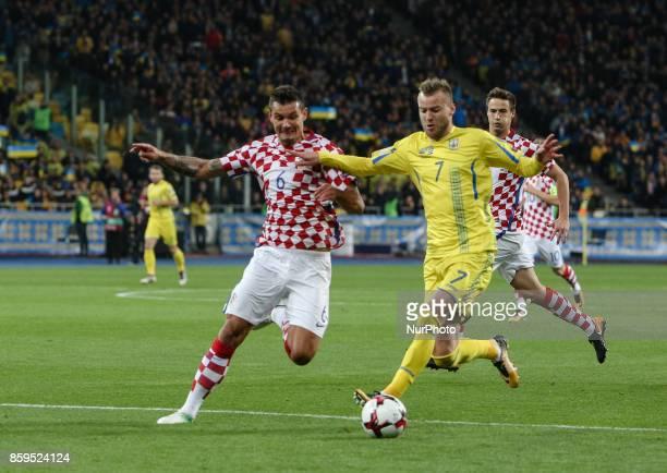 Andriy Yarmolenko of Ukraine in action against Croatian Dejan Lovren during the FIFA 2018 World Cup Group I Qualifier between Ukraine and Croatia at...