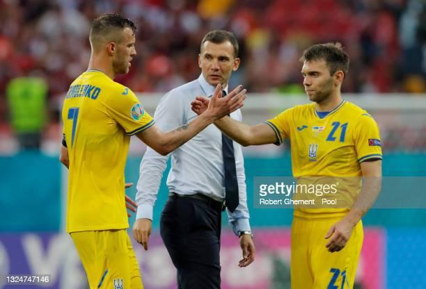Andriy Yarmolenko of Ukraine interacts with team mate Oleksandr Karavaev as Andriy Shevchenko, Head Coach of Ukraine looks on after the UEFA Euro...