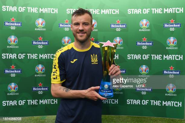 """Andriy Yarmolenko of Ukraine poses for a photograph with their Heineken """"Star of the Match"""" award after the UEFA Euro 2020 Championship Group C match..."""
