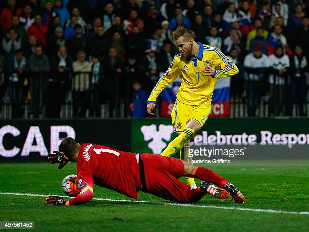 Andriy Yarmolenko of Ukraine scores a last second goal past Samir Handanovic of Slovenia during the UEFA EURO 2016 qualifier playoff second leg match...