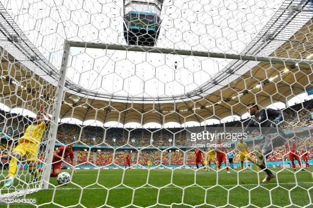 Andriy Yarmolenko of Ukraine scores their side's first goal past Stole Dimitrievski of North Macedonia during the UEFA Euro 2020 Championship Group C...