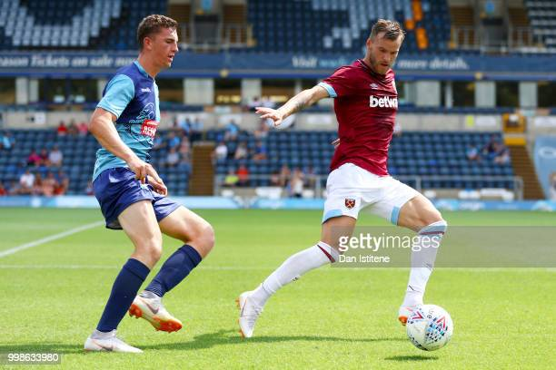 Andriy Yarmolenko of West Ham battles for the ball during the preseason friendly match between Wycombe Wanderers and West Ham United at Adams Park on...