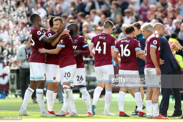 Andriy Yarmolenko of West Ham celebrates scoring their 2nd goal as his teammates receive coaching from West Ham manager Manuel Pellegrini during the...